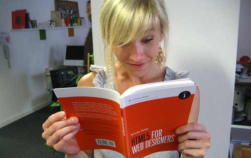 Shannon reading HTML5 For Web Designers by Jeremy Keith